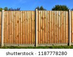 Small photo of Two panels of a classic wooden featheredge garden fence with concrete support posts