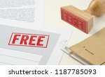 a red stamp on a document   free | Shutterstock . vector #1187785093