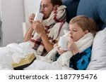 ill father and son in scarves... | Shutterstock . vector #1187795476