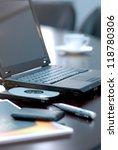 laptop over office accessories | Shutterstock . vector #118780306