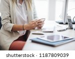 unrecognisable businesswoman... | Shutterstock . vector #1187809039