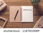 2019 goals list in notebook... | Shutterstock . vector #1187810089