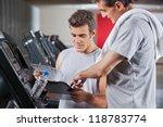 instructor guiding man to fill... | Shutterstock . vector #118783774