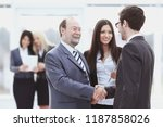 welcome and handshake of... | Shutterstock . vector #1187858026