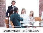 business partners conducting a... | Shutterstock . vector #1187867329