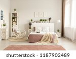 rocking chair next to bed with... | Shutterstock . vector #1187902489