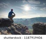 hiker watching to sun at... | Shutterstock . vector #1187919406