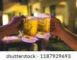 two glasses of beer cheers... | Shutterstock . vector #1187929693