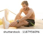 sportsman warming up before... | Shutterstock . vector #1187956096