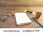 top view of working desk with... | Shutterstock . vector #1188012799