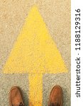feet and arrows on road. | Shutterstock . vector #1188129316