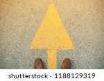 feet and arrows on road. | Shutterstock . vector #1188129319