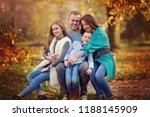 autumn portrait of happy family ...   Shutterstock . vector #1188145909