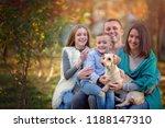 autumn portrait of happy family ...   Shutterstock . vector #1188147310