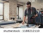 fashion designer working in his ... | Shutterstock . vector #1188212110