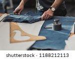 fashion designer working in his ... | Shutterstock . vector #1188212113