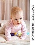 portrait of curious baby girl... | Shutterstock . vector #118826923