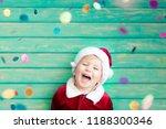 portrait of child wearing santa ... | Shutterstock . vector #1188300346