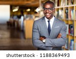 Stock photo smiling and cheerful african american business professional attorney at law office 1188369493