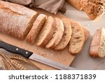 loaf of bread cut into slices... | Shutterstock . vector #1188371839