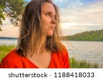 beautiful woman in red dress by ... | Shutterstock . vector #1188418033