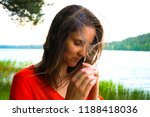 beautiful woman in red dress by ... | Shutterstock . vector #1188418036