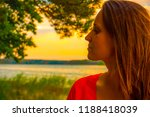 beautiful woman in red dress by ... | Shutterstock . vector #1188418039