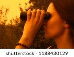 woman with binoculars | Shutterstock . vector #1188430129