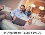 mature couple using laptop at... | Shutterstock . vector #1188519103