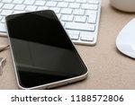modern smartphone on a keyboard ...   Shutterstock . vector #1188572806