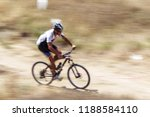 a cyclist on a mountain bike on ... | Shutterstock . vector #1188584110