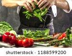 chef cook preparing vegetables...   Shutterstock . vector #1188599200