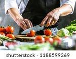 chef cook preparing vegetables... | Shutterstock . vector #1188599269