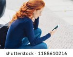 young redhead woman sitting... | Shutterstock . vector #1188610216