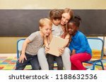 kids and caregivers using... | Shutterstock . vector #1188632536