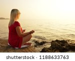woman practicing yoga by the... | Shutterstock . vector #1188633763