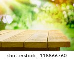 empty wooden table with garden... | Shutterstock . vector #118866760