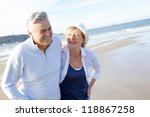 senior couple walking on the... | Shutterstock . vector #118867258