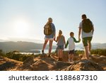 rear view of family standing at ... | Shutterstock . vector #1188687310