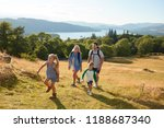 family climbing hill on hike... | Shutterstock . vector #1188687340