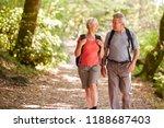 senior couple hiking along...   Shutterstock . vector #1188687403