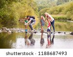 family crossing river whilst... | Shutterstock . vector #1188687493
