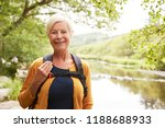 Portrait Of Senior Woman Hikin...