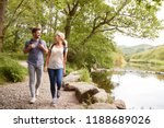 Couple Hiking Along Path By...
