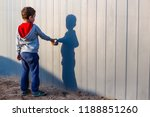 boy and his shadow. lonely... | Shutterstock . vector #1188851260