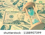 hourglass or sandglass on us... | Shutterstock . vector #1188907399