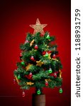 festive christmas tree on red... | Shutterstock . vector #1188931759