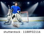 young goalie in the spotlight... | Shutterstock . vector #1188932116