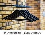 wooden coat hanger clothes.... | Shutterstock . vector #1188998509