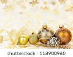 Golden Christmas background with gold balls and ornaments - stock photo